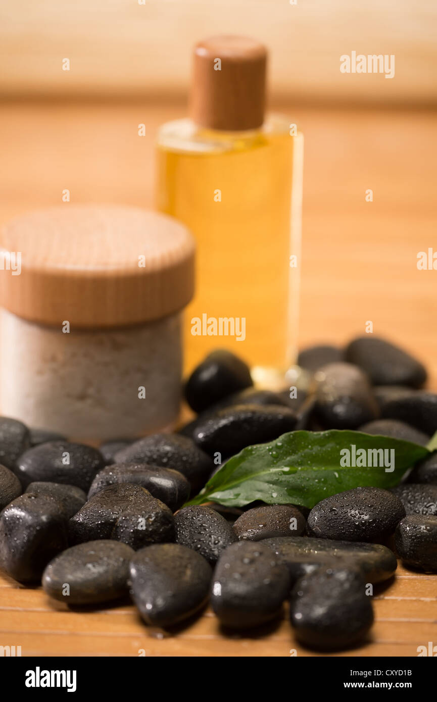 Spa zen stones with salt and oil still nature setting - Stock Image