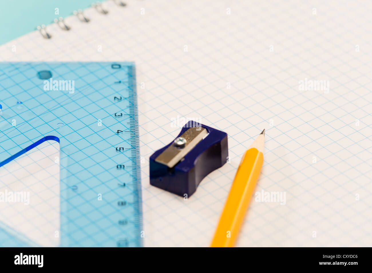 Sharpener with ruler, pencil on notepad school supplies - Stock Image