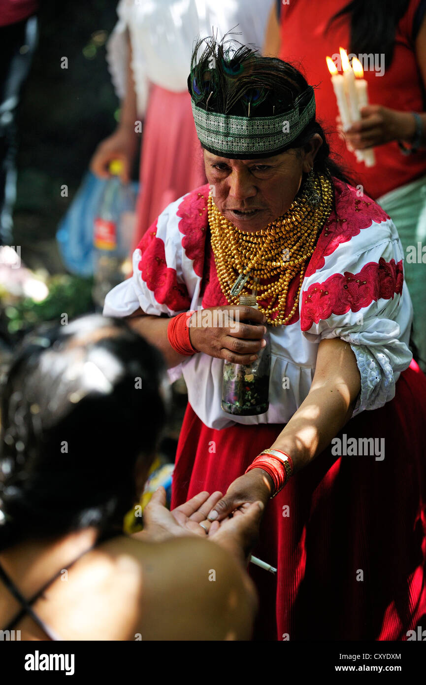 Healer, wise woman, during traditional ablutions to ward off evil spirits and to cleanse the soul of the indigenous - Stock Image