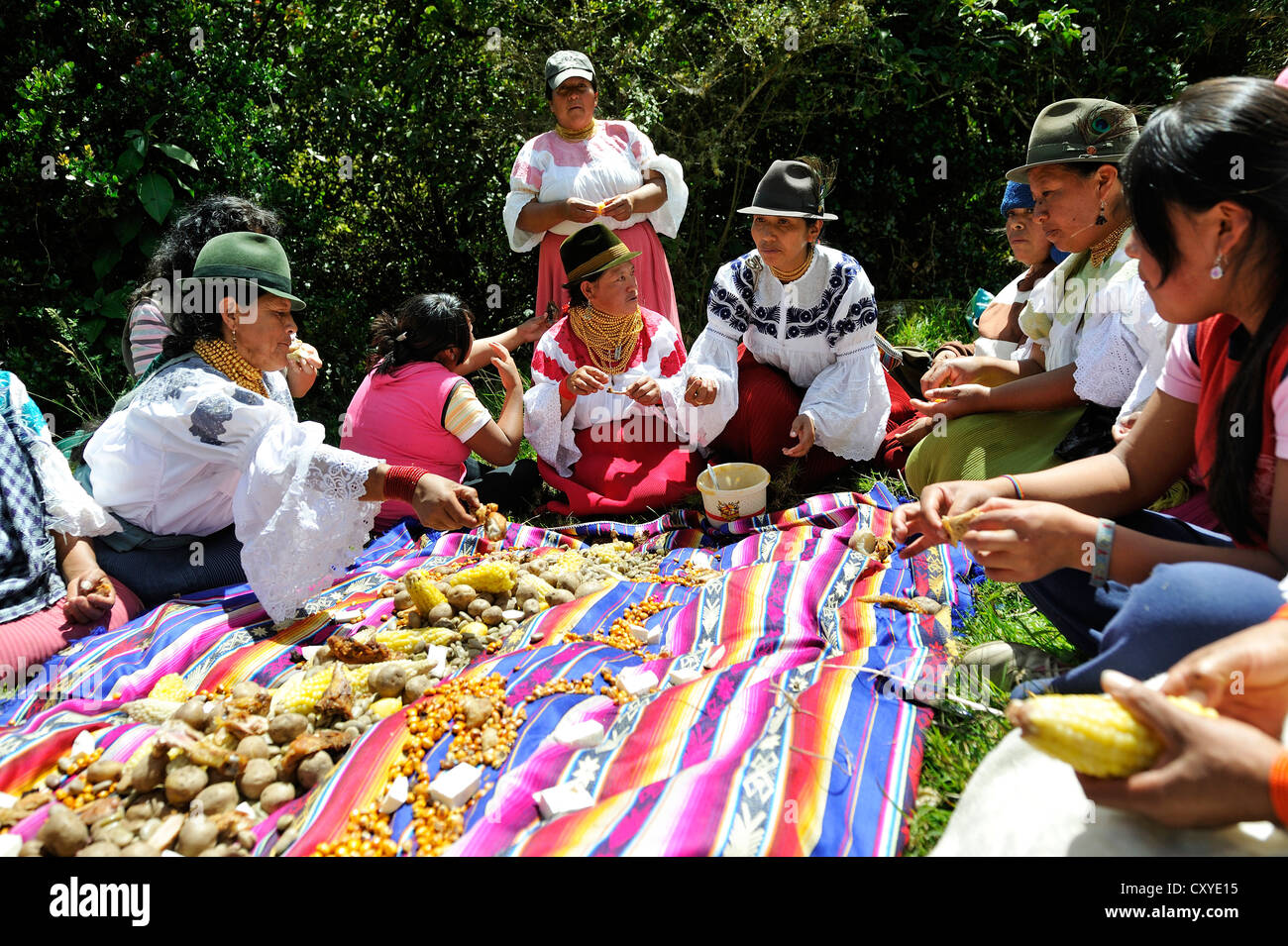 Communal meal before traditional ablutions to ward off evil spirits and to cleanse the soul of the indigenous Caranqui - Stock Image