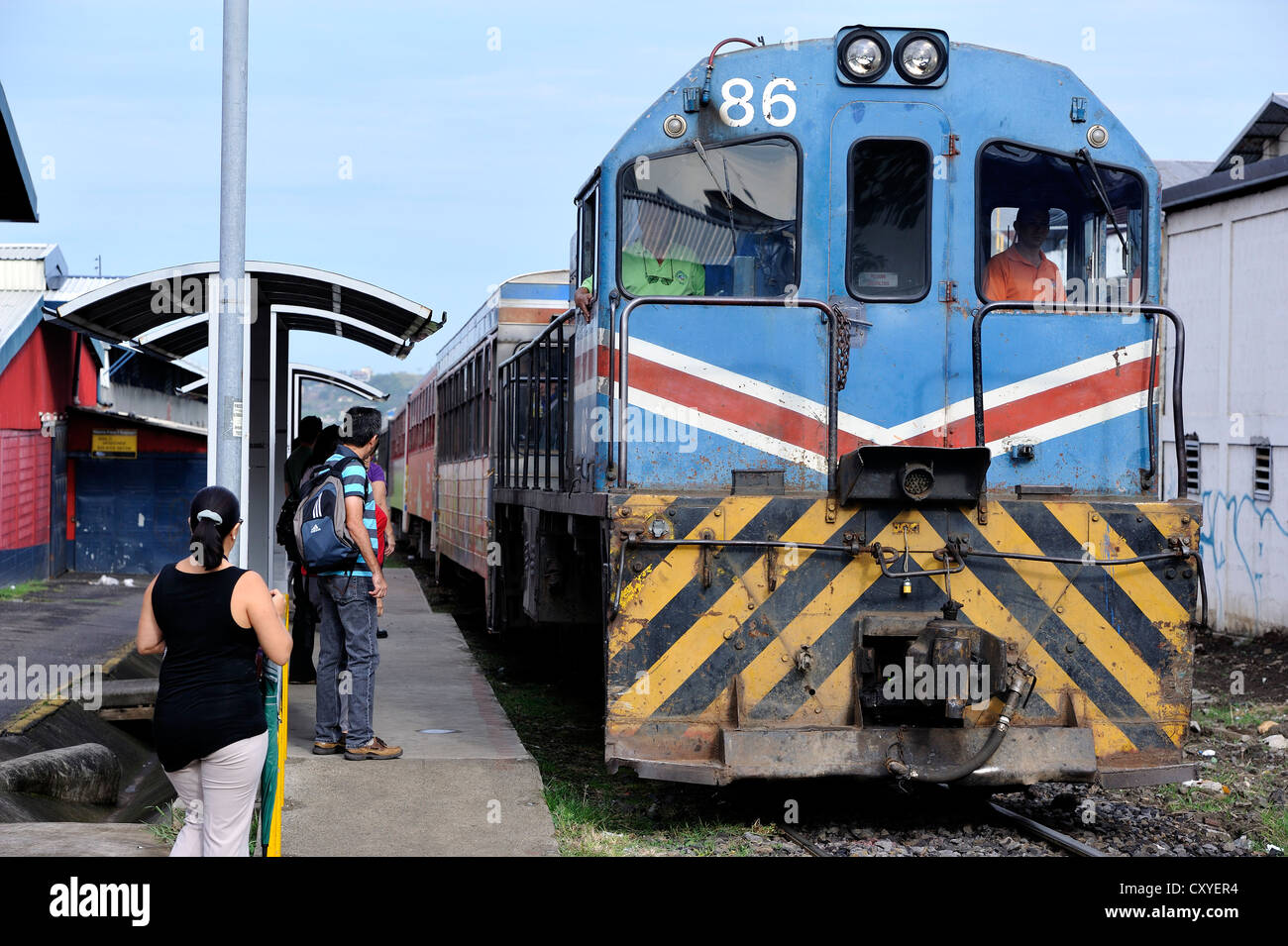 Commuter train with a diesel locomotive entering the station, San Jose, Costa Rica, Latin America, Central America - Stock Image