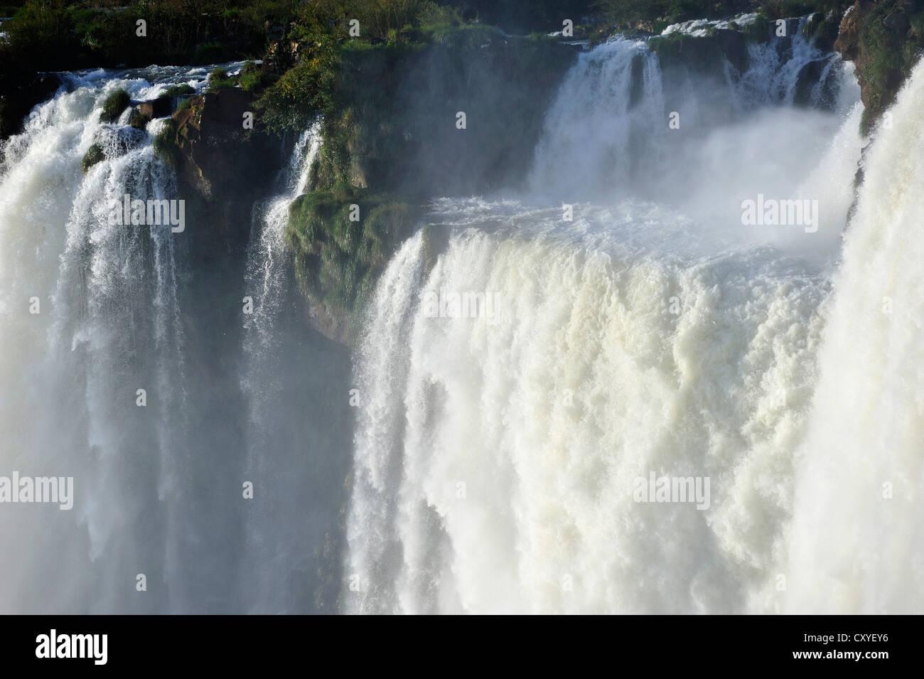 Cascades at the Devil's Throat, Garganta del Diablo, Iguazu or Iguacu Falls, UNESCO World Heritage Site, at - Stock Image