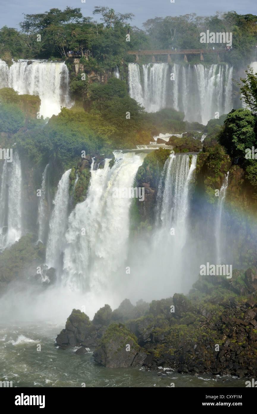 Iguazu or Iguacu Falls, UNESCO World Heritage Site, with rainbow, at the border of Brazil and Argentina - Stock Image