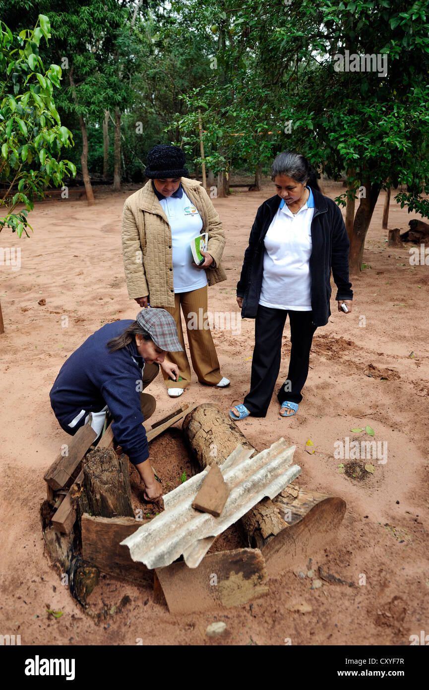 Farmer and health promoter in her garden for medicinal plants, passing on her knowledge about natural remedies to Stock Photo