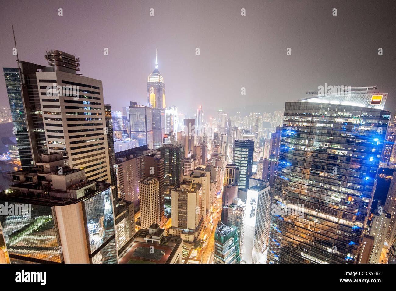 HONG KONG, SAR of CHINA: Aerial view of streets of Central district in Hong Kong at night - Stock Image