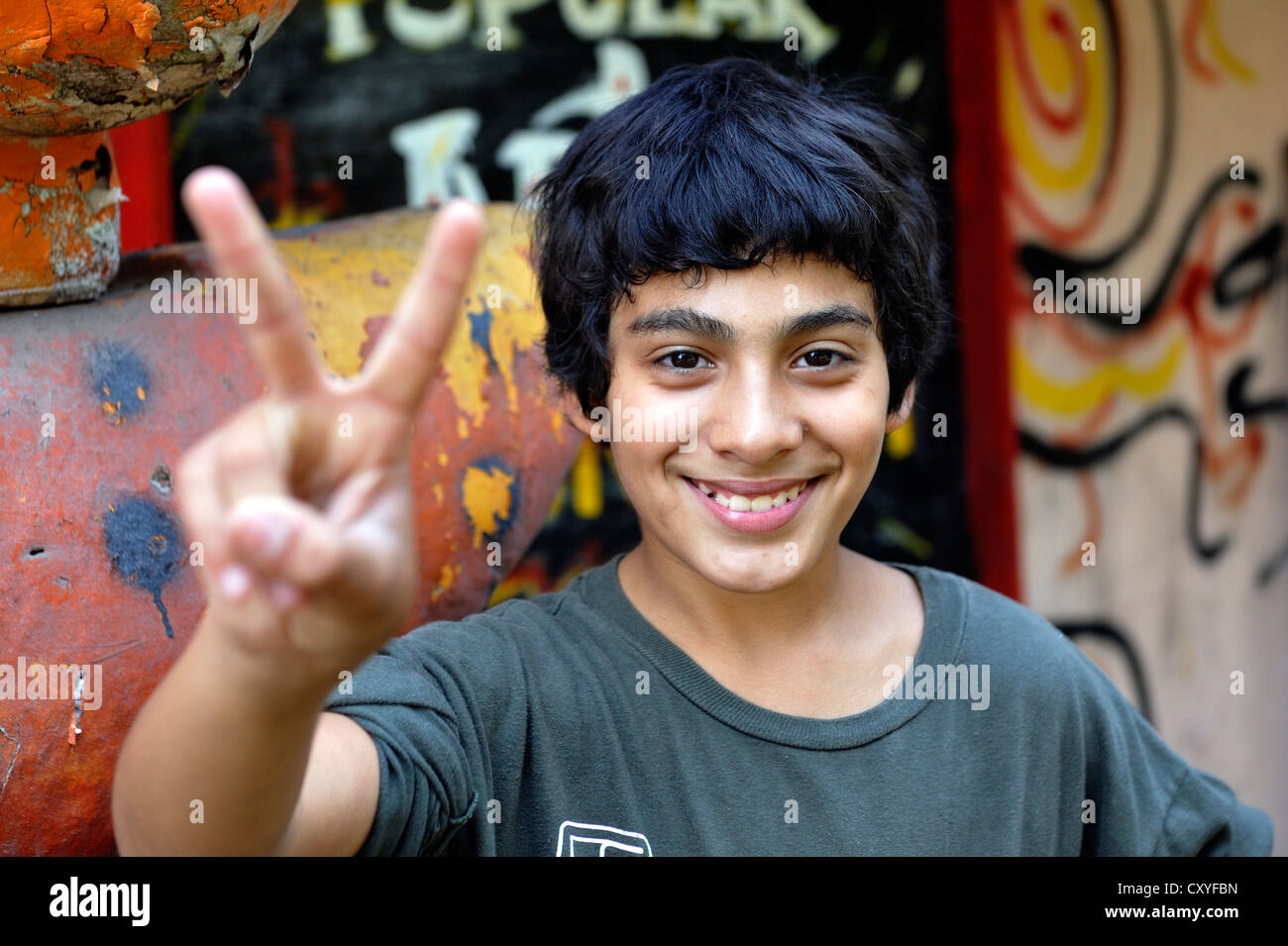 Young person making the 'victory' sign, Buenos Aires, Argentina, South America - Stock Image