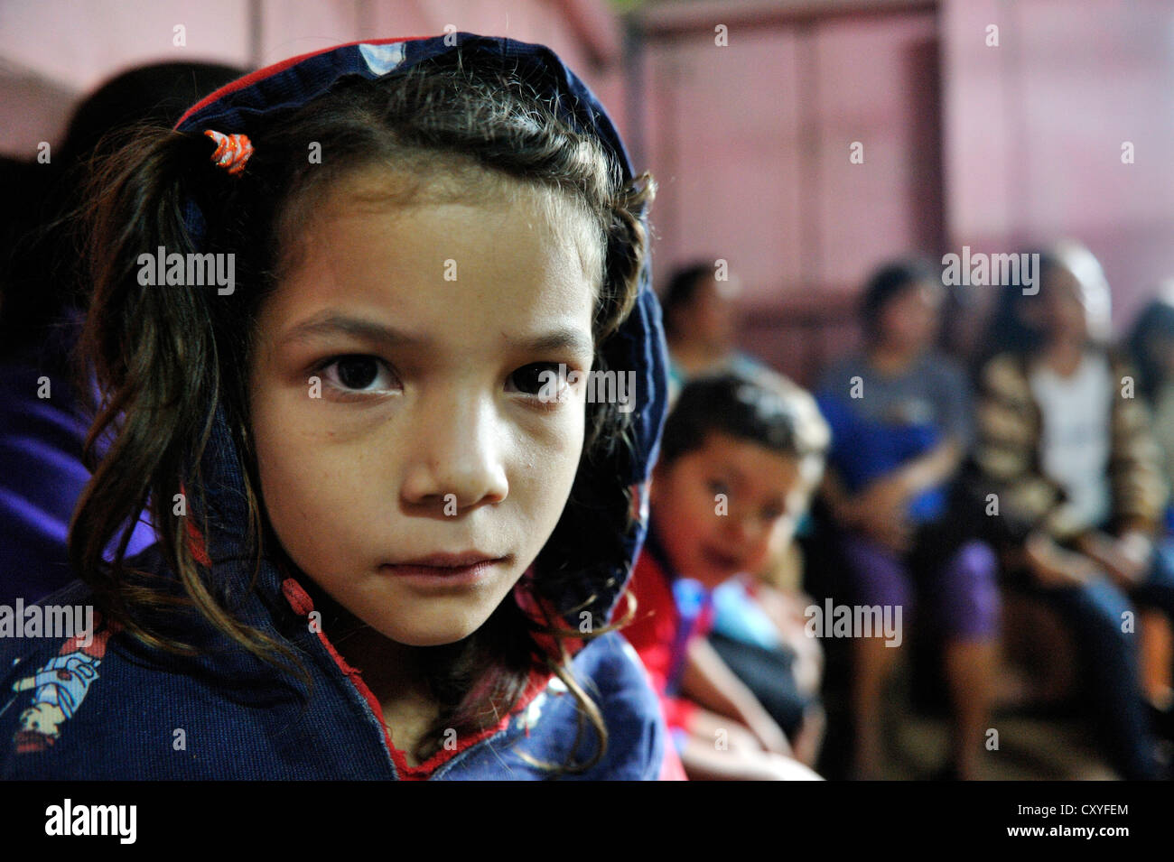 Girl during a meeting of an aid organisation that provides health services and information for mothers and children, Stock Photo