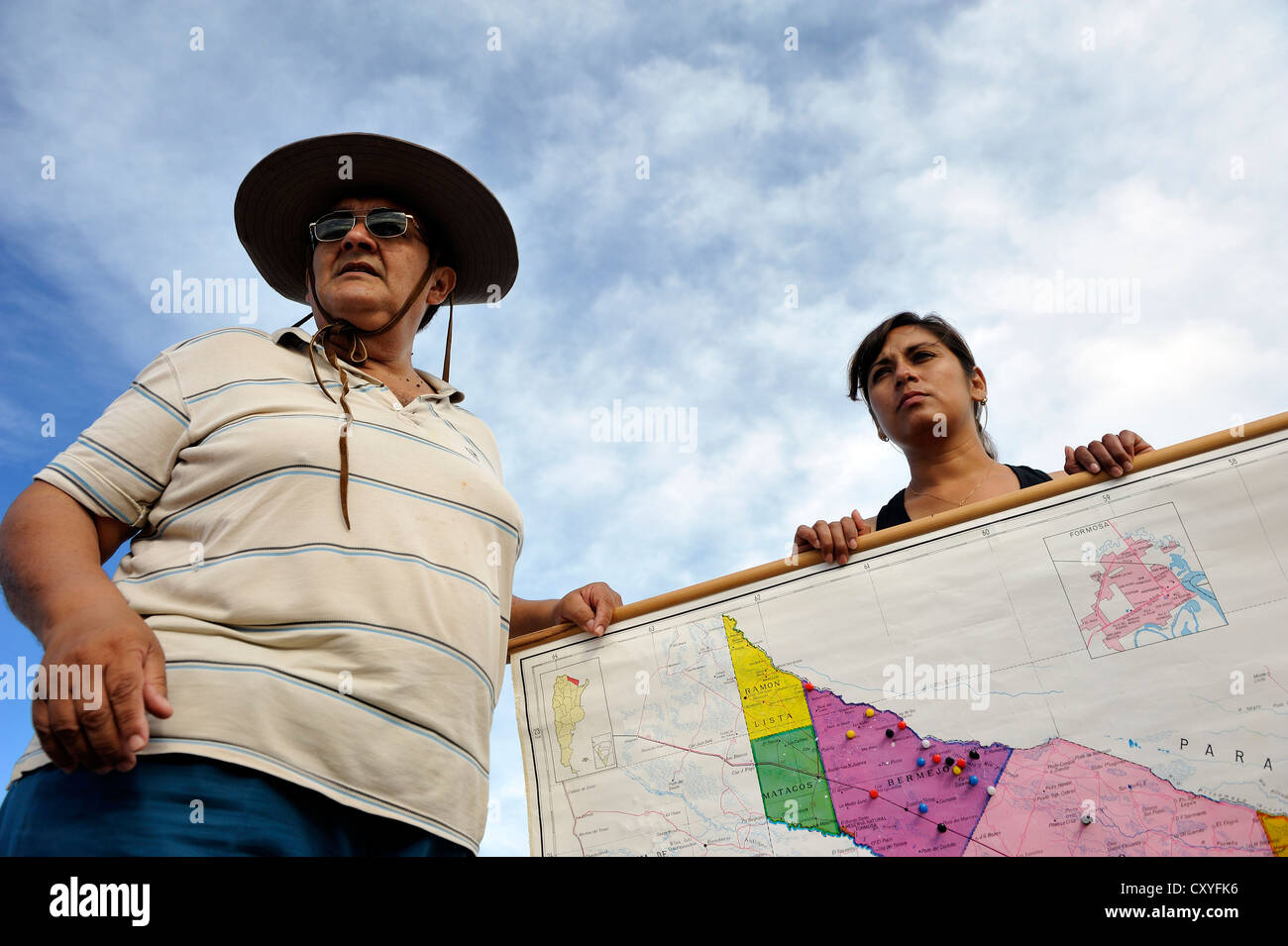 Environmental activists with a map of the floodplains of the Pilcomayo river, the area is being destroyed by a project - Stock Image