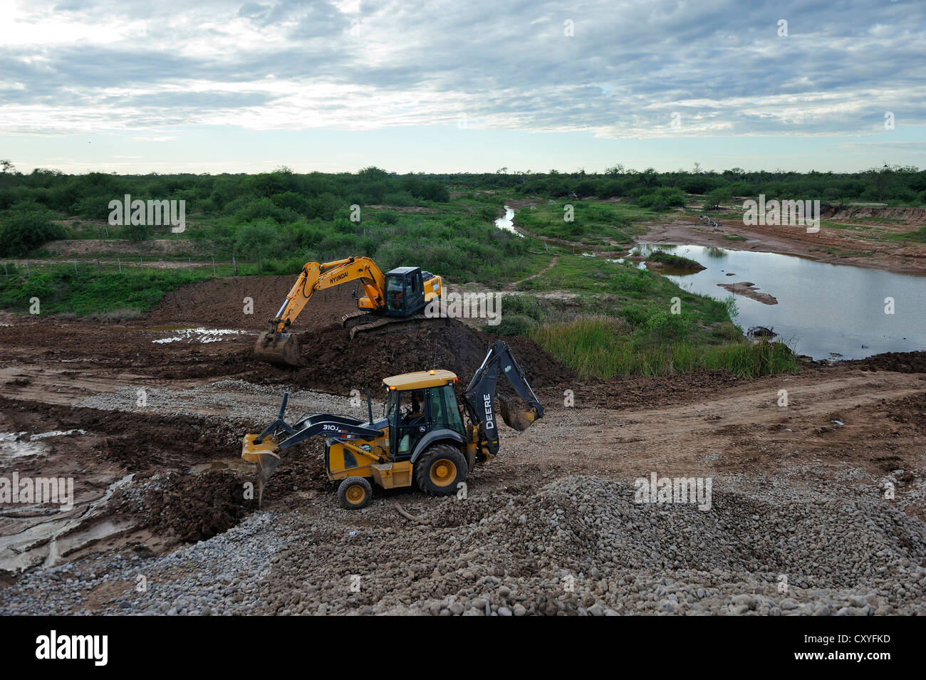 Construction works at a controversial road through the floodplains of the Pilcomayo River, a project supported by - Stock Image