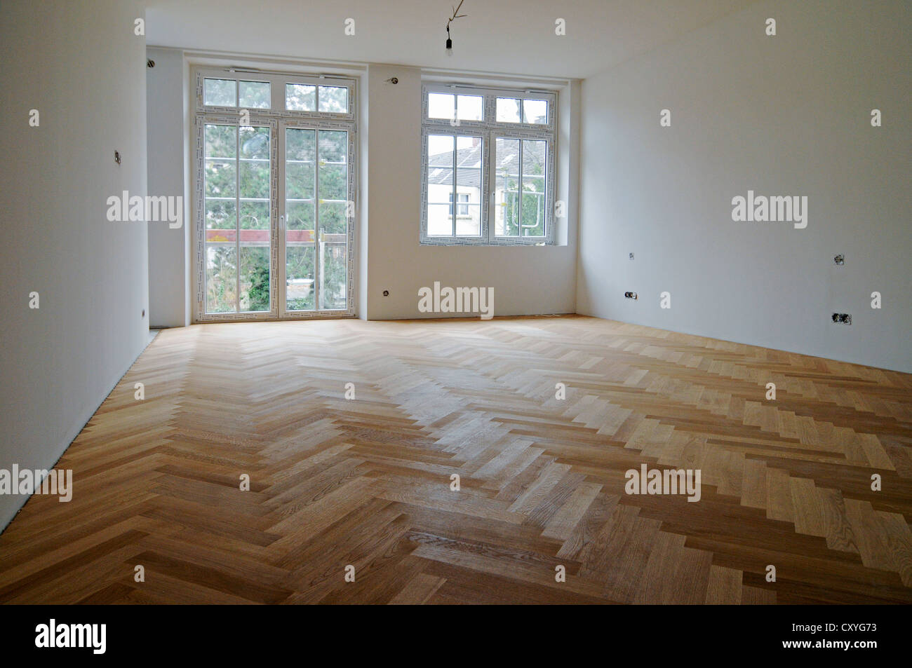 Newly laid parquet flooring, wooden floor, building renovation - Stock Image