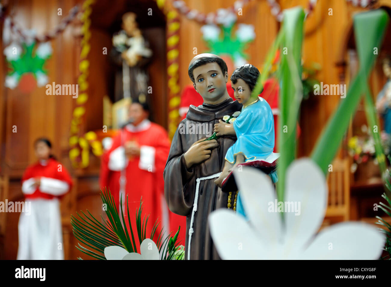 Statue of a saint, St. Anthony, Whitsun mass, Dios Con Nosotros church parish, El Mesquital, Guatemala City, Guatemala - Stock Image