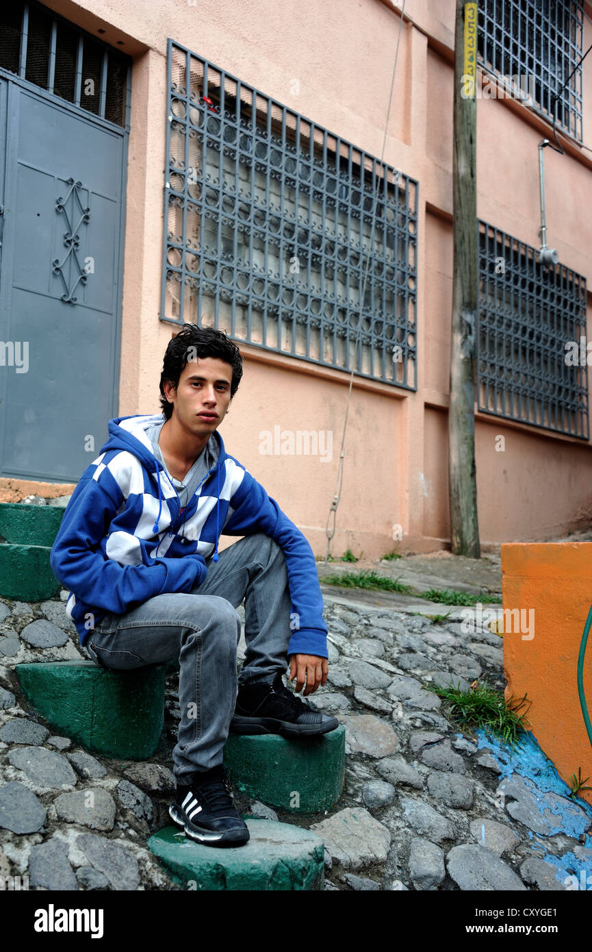 Young man, 18 years old, a former hired killer and member of a gang of youths, Mara, in his former district, El - Stock Image