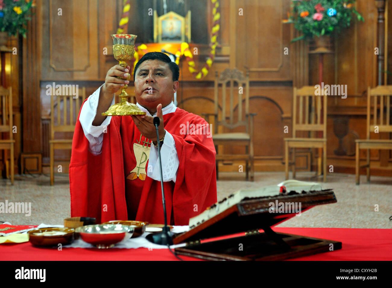 Whitsun mass, consecration, Dios Con Nosotros church parish, El Mesquital, Guatemala City, Guatemala, Central America - Stock Image