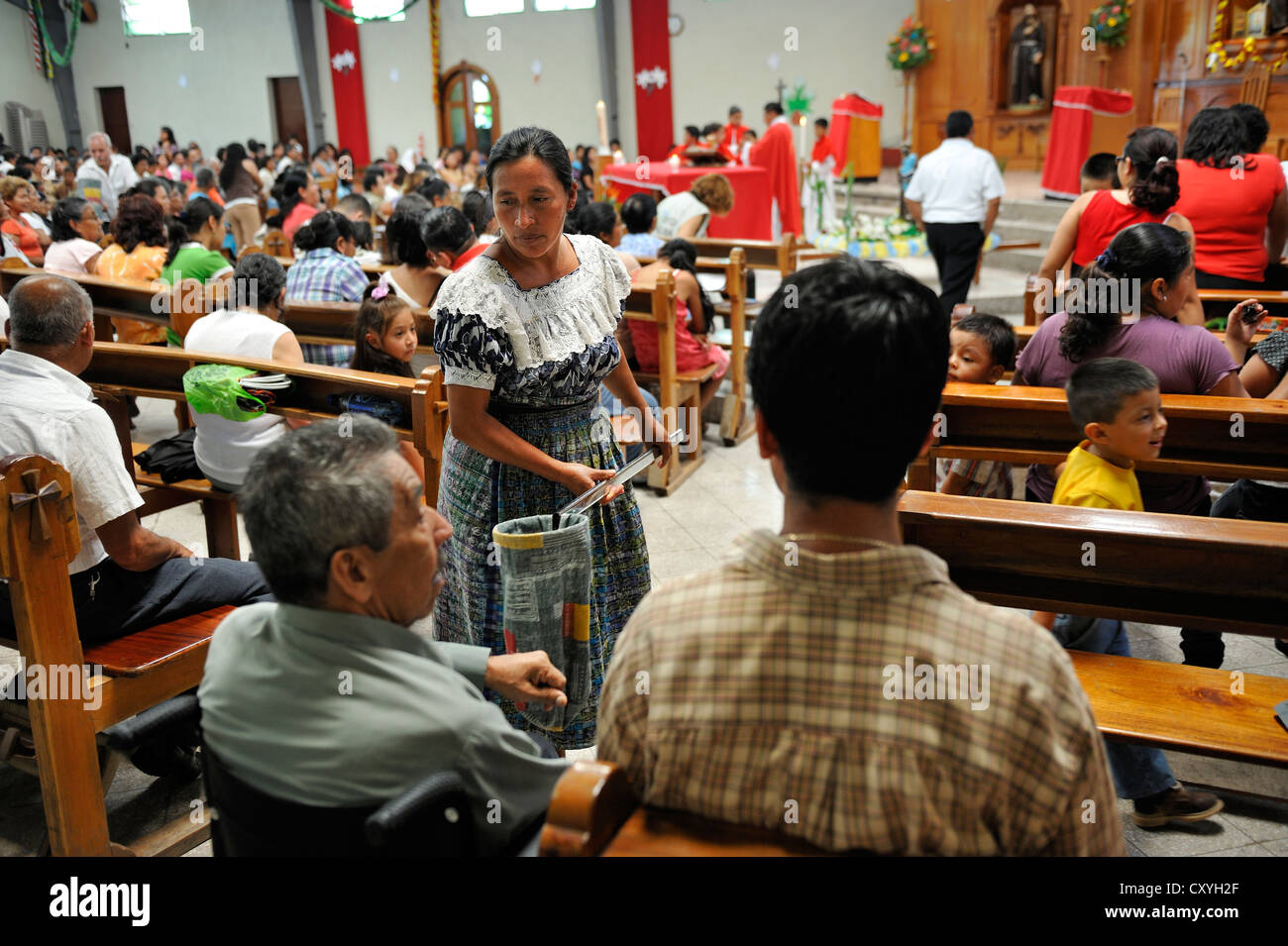 Collecte, Whitsun mass, Dios Con Nosotros church parish, El Mesquital, Guatemala City, Guatemala, Central America - Stock Image