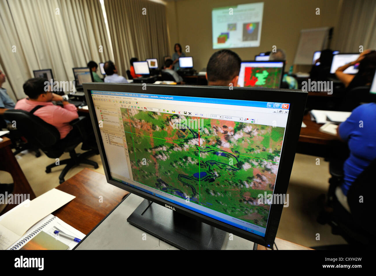 Forest managers are being trained how to read satellite images, monitoring system to monitor the deforestation of - Stock Image
