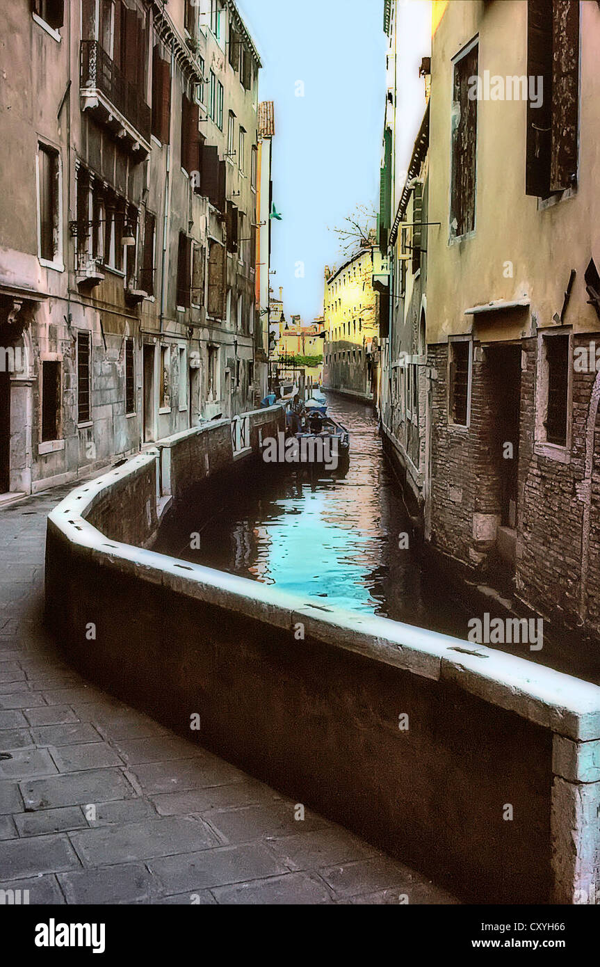 An artistic, stylised view of a small side canal in Venice, Italy, with an antique feel. - Stock Image