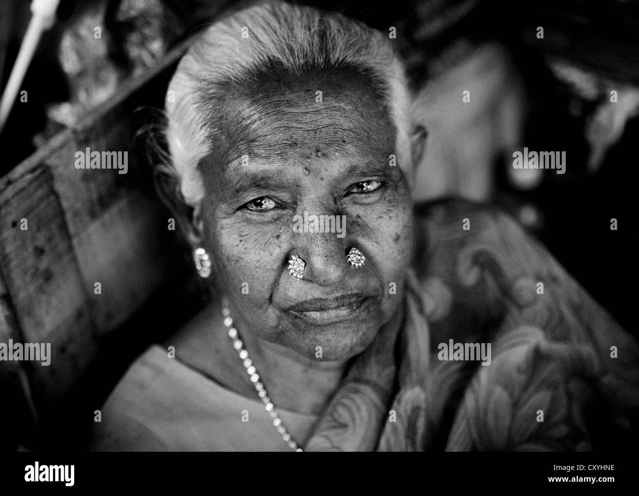 Portrait Of An Old Woman With White Hairs And Nose Piercings Stock