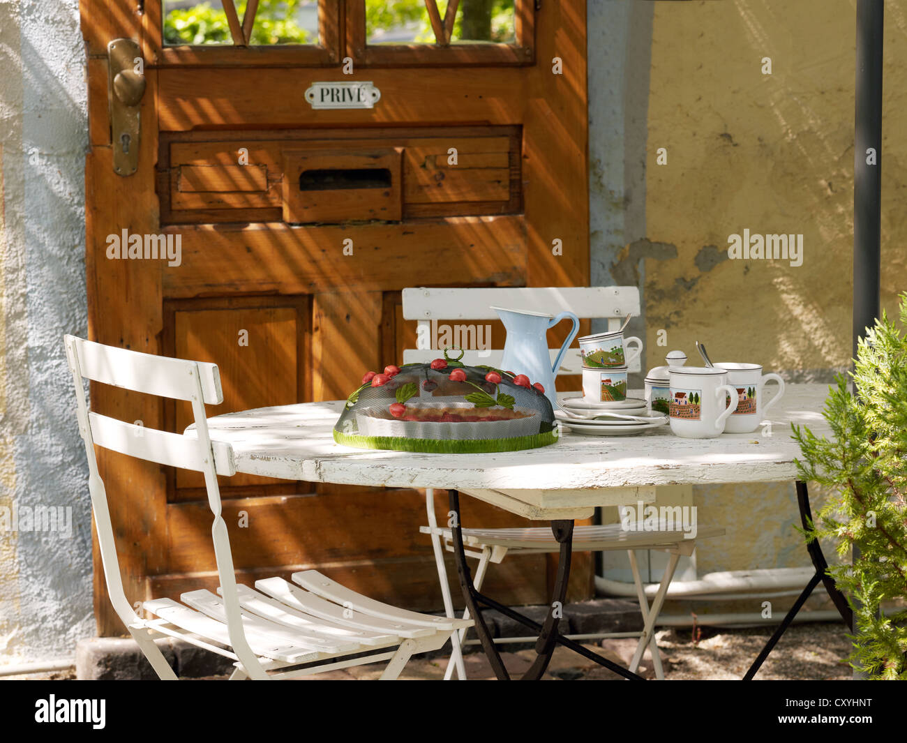 Summerly, decoratively laid coffee table - Stock Image