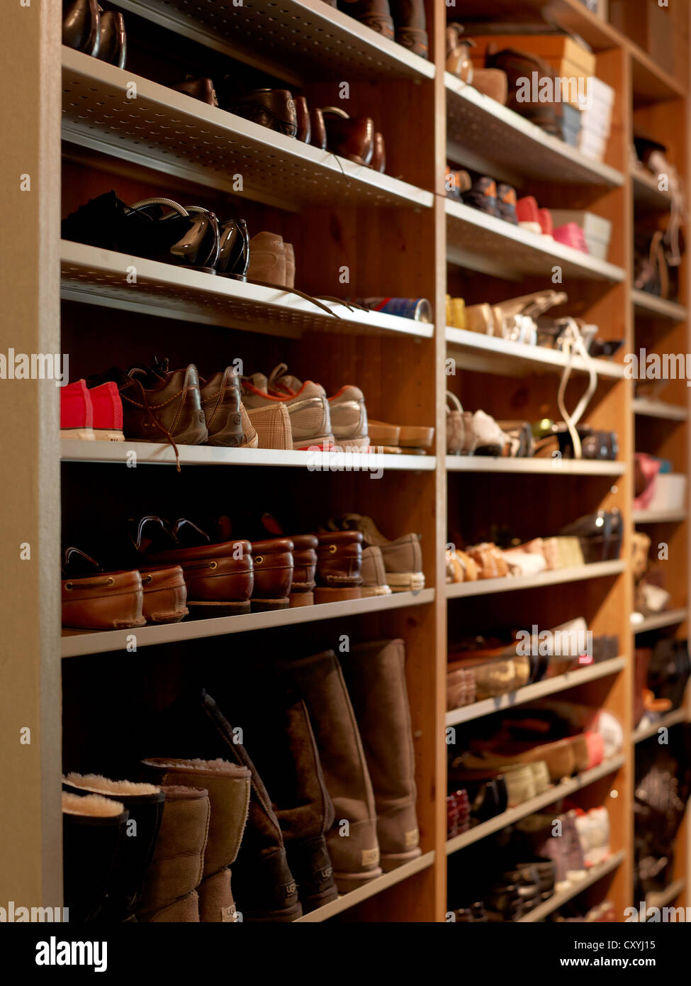 Open Shoe Rack In A Large Family Household   Stock Image