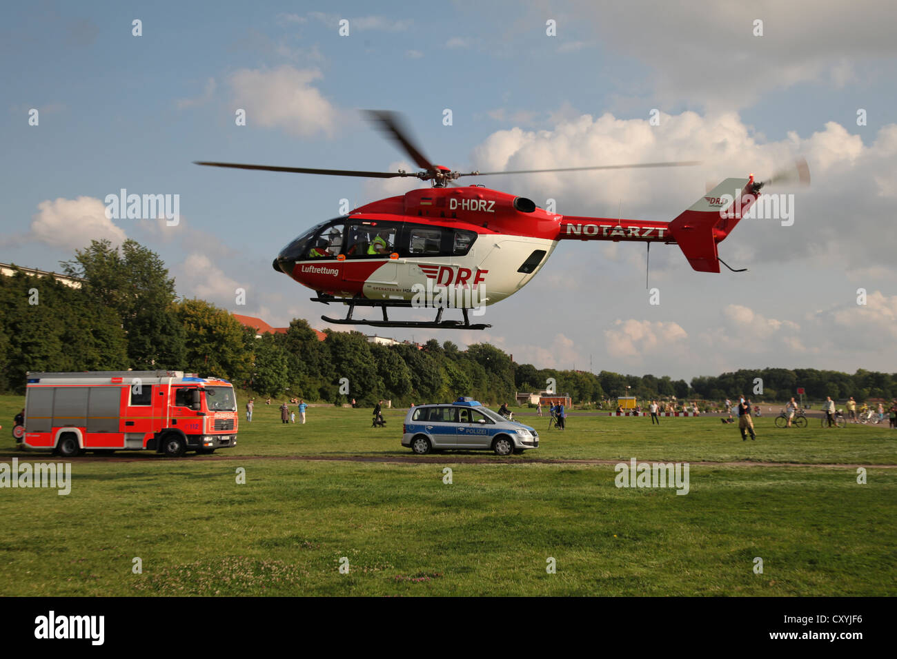 Air ambulance in action, after sustaining severe burns, a 15-year-old girl is flown by rescue helicopter from Tempelhof - Stock Image