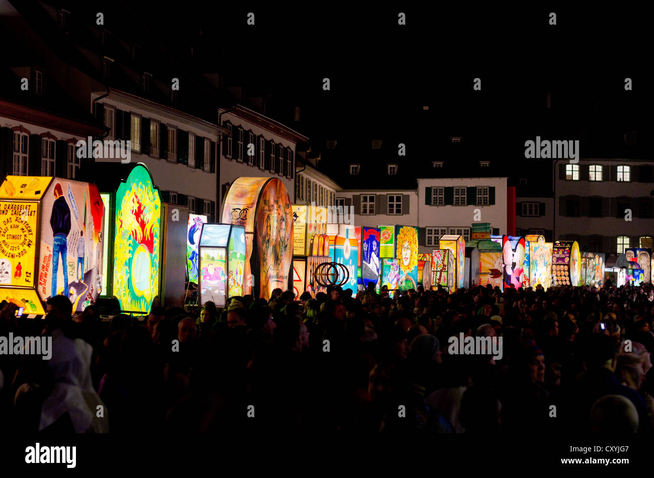 Muensterplatz square at night, decorated with big lanterns on social and political subjects, Basel, Switzerland, Stock Photo