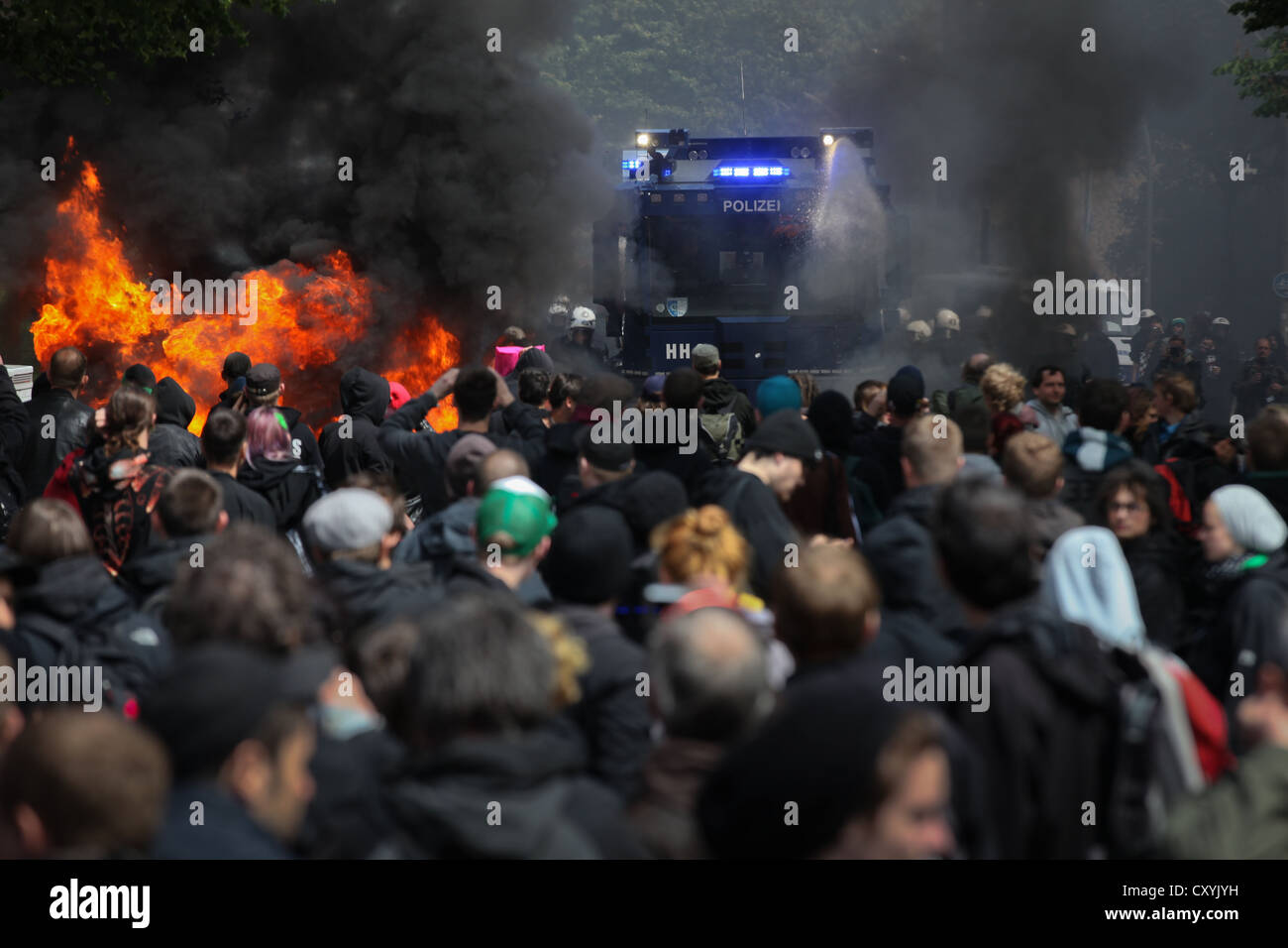 Use of water cannon against anti-Nazi protesters, the left-wing protesters tried to stop a rally of neo-Nazis with - Stock Image