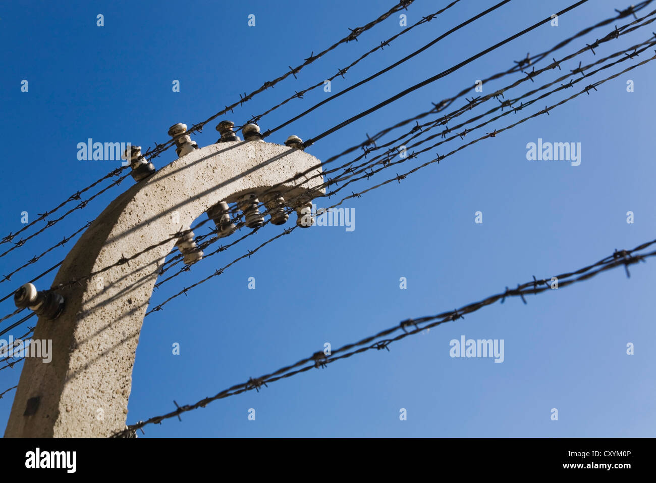 Barb wire electric fence inside the Auschwitz I former Nazi Concentration Camp, Auschwitz, Poland, Europe - Stock Image