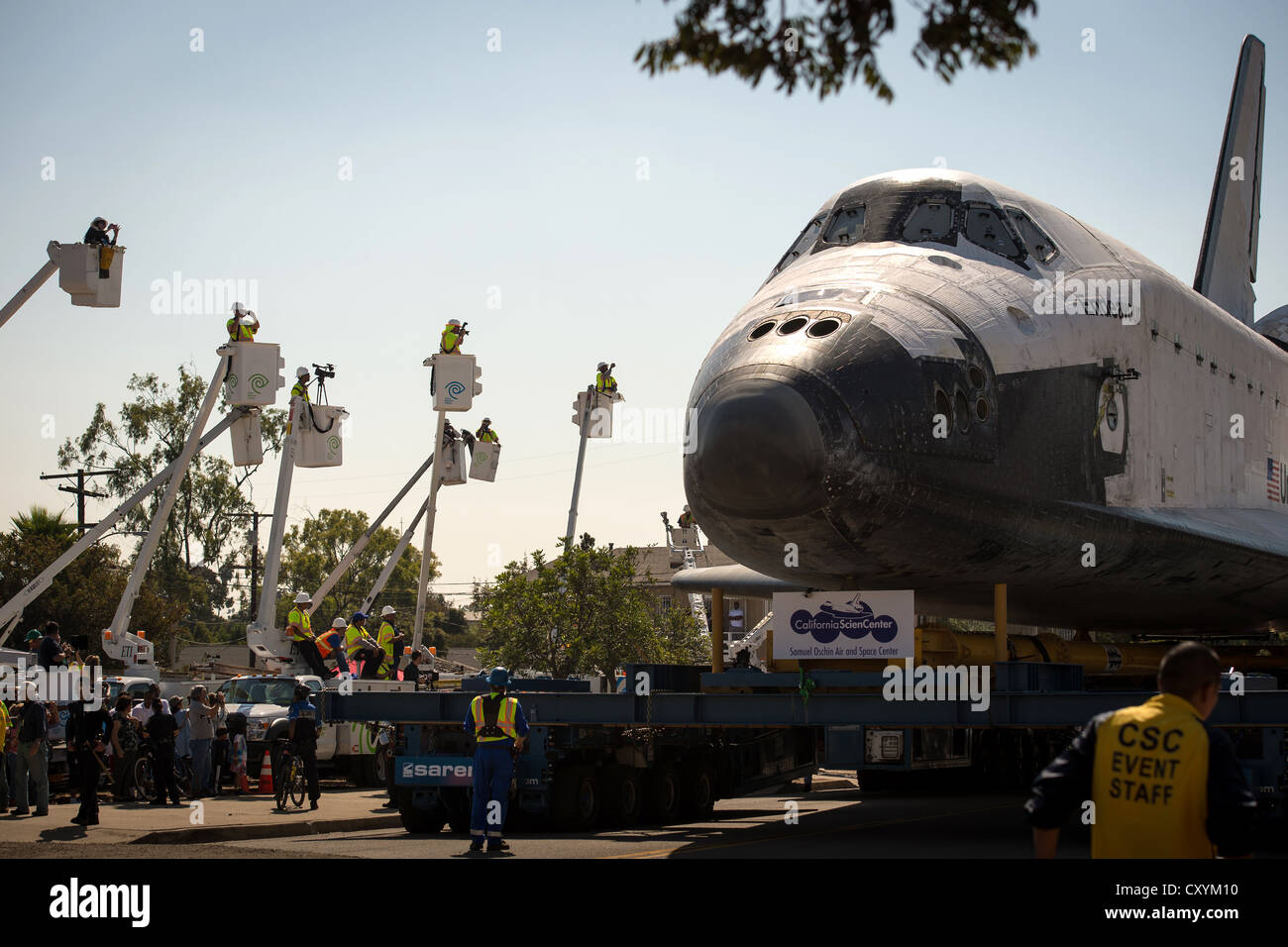 NASA space shuttle Endeavour is maneuvered streets of Inglewood while on a 12-mile trip by road to its new home - Stock Image