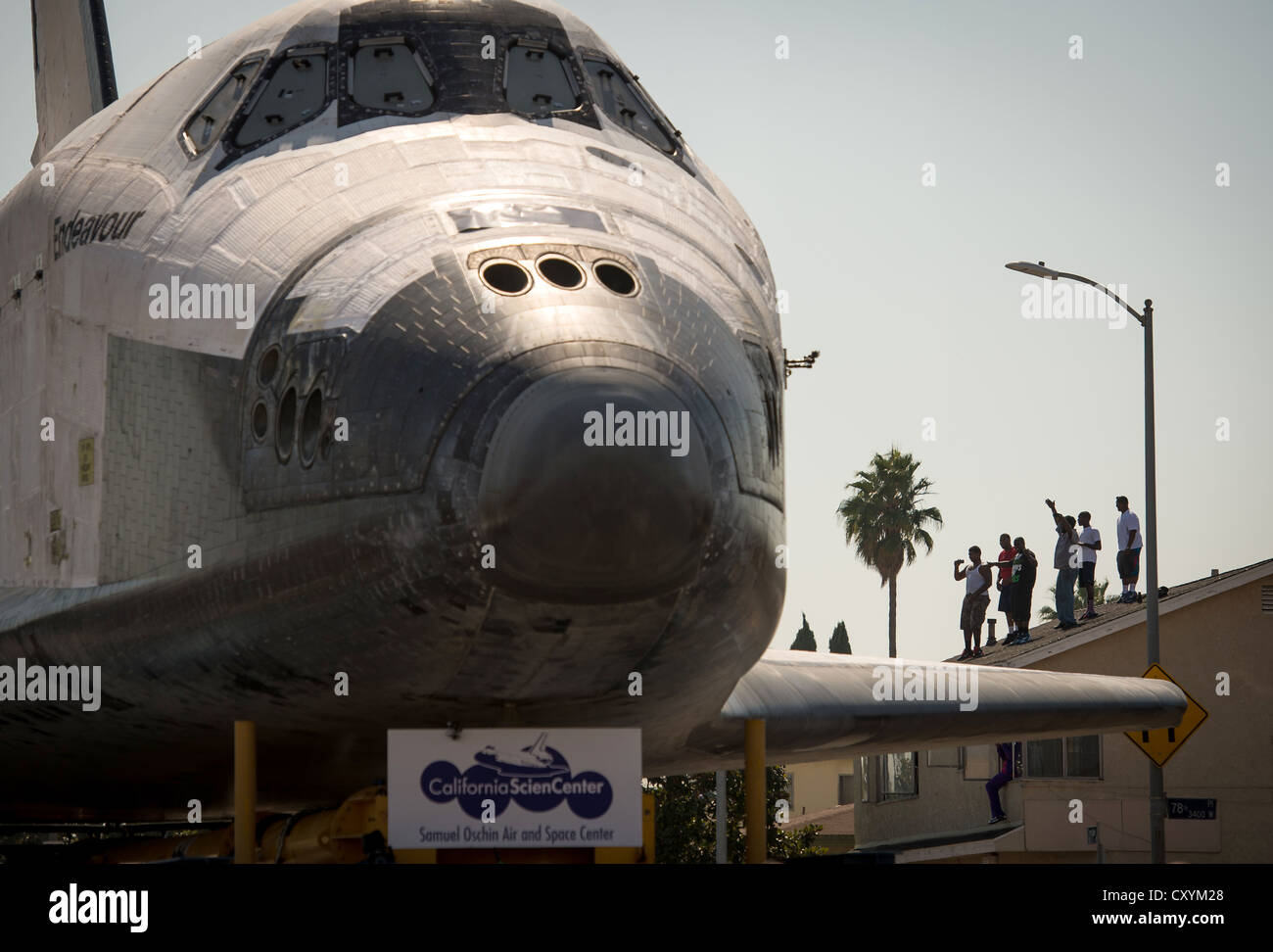 NASA space shuttle Endeavour is maneuvered on Crenshaw Blvd while on a 12-mile trip by road to its new home at the - Stock Image