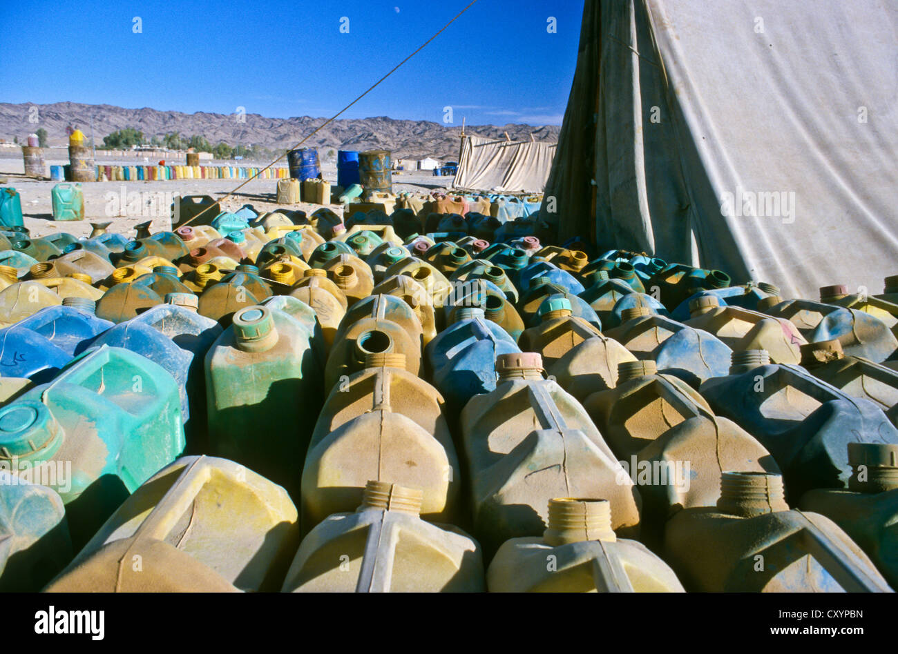 Petrol station selling smuggled petrol from Iran to truck drivers in Pakistan, Noshki, Belouchistan, Pakistan, Asia Stock Photo