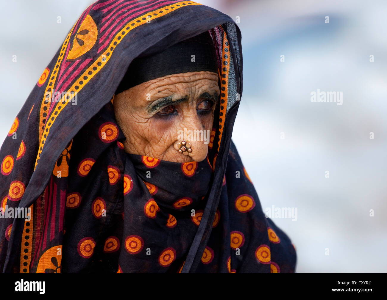 Old Woman In Colourful Costums And Flower Shaped Nose Piercing Stock