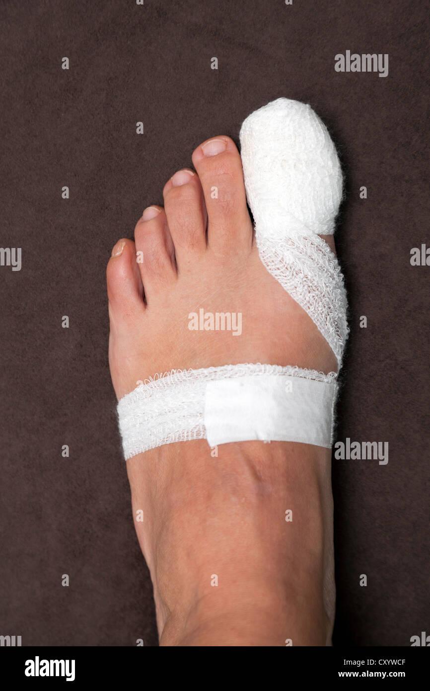 Big toe, bandage, after surgery - Stock Image