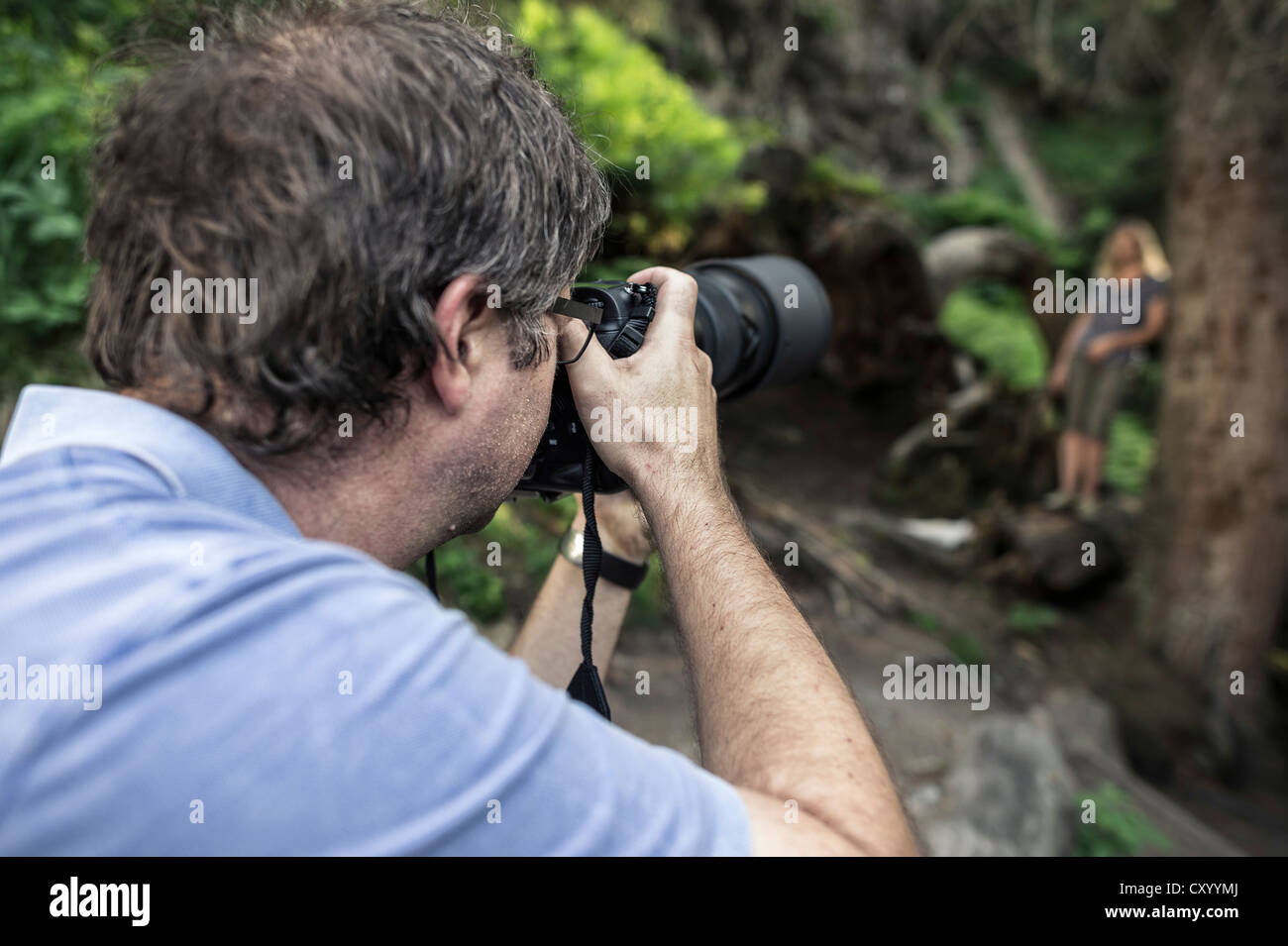Photographer and model during a photo shoot in the woods, Stubai Valley, Tyrol, Austria, Europe - Stock Image
