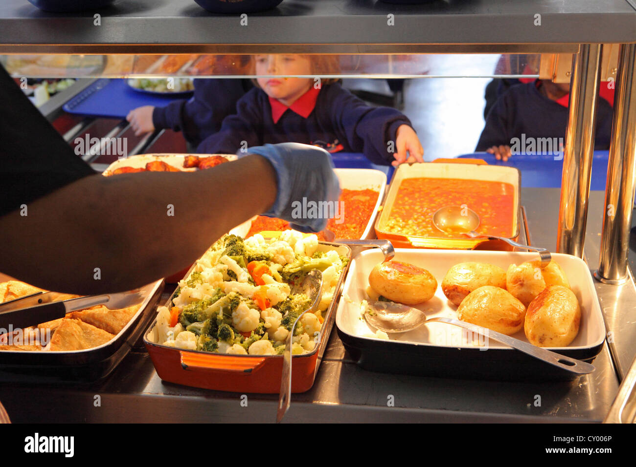 Primary school lunchtime, School Canteen child chooses, school dinner, London, UK - Stock Image