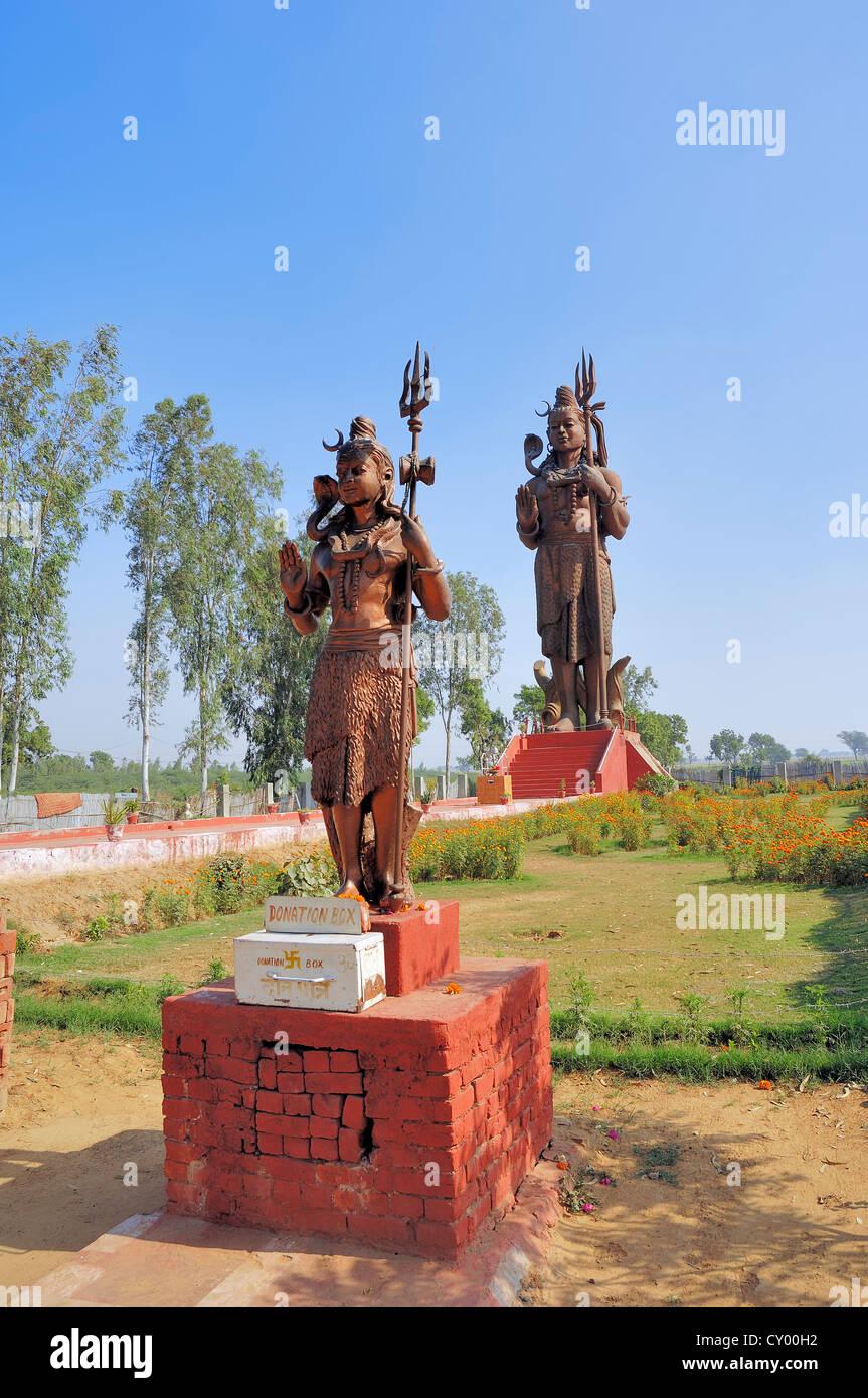 Statues of the Hindu God Shiva or Lord Shiva, near New Delhi, India, Asia - Stock Image
