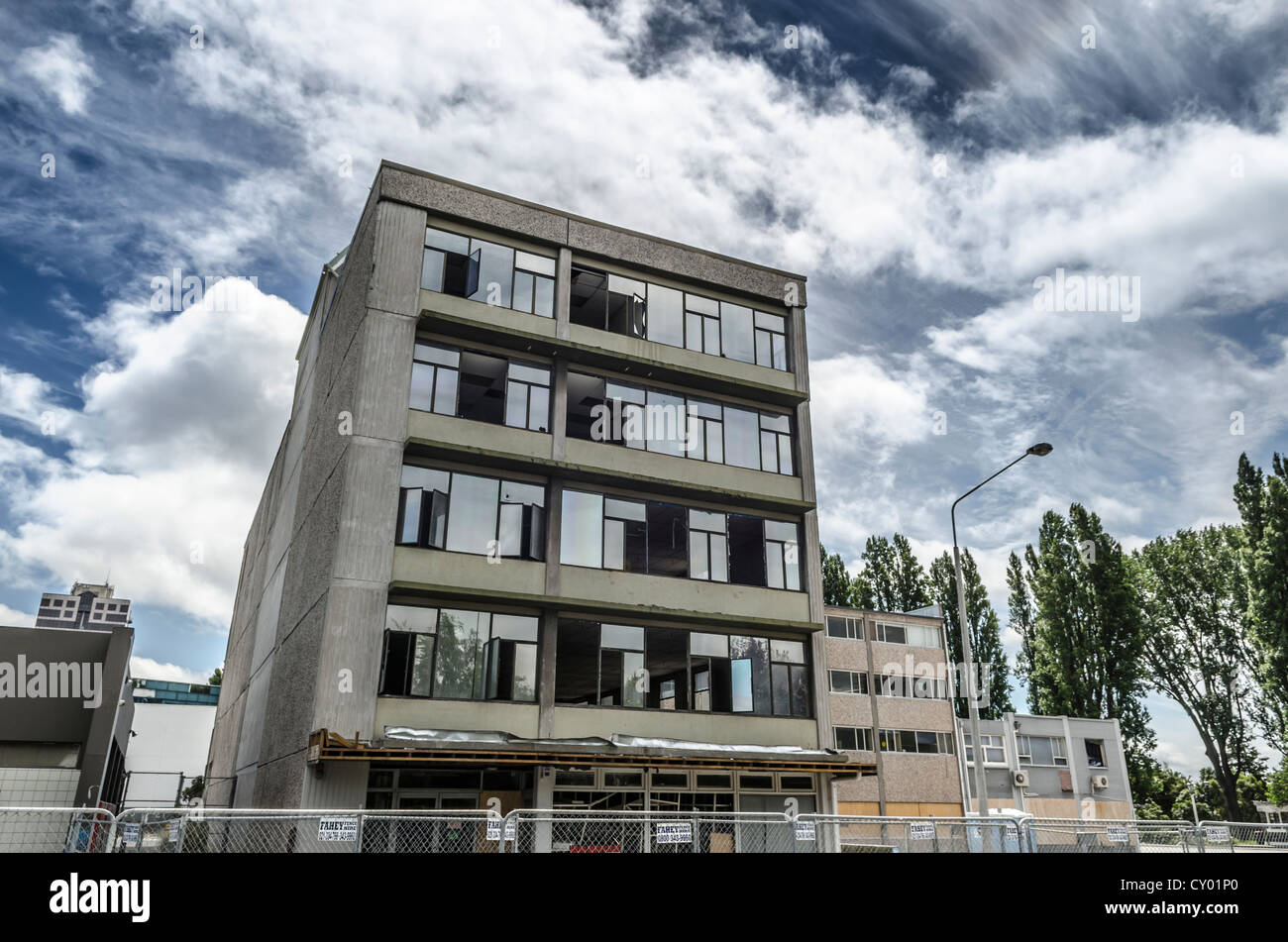 Modern building damaged by earthquakes in the evacuated city centre, CBD Red Zone, Christchurch, South Island, New - Stock Image