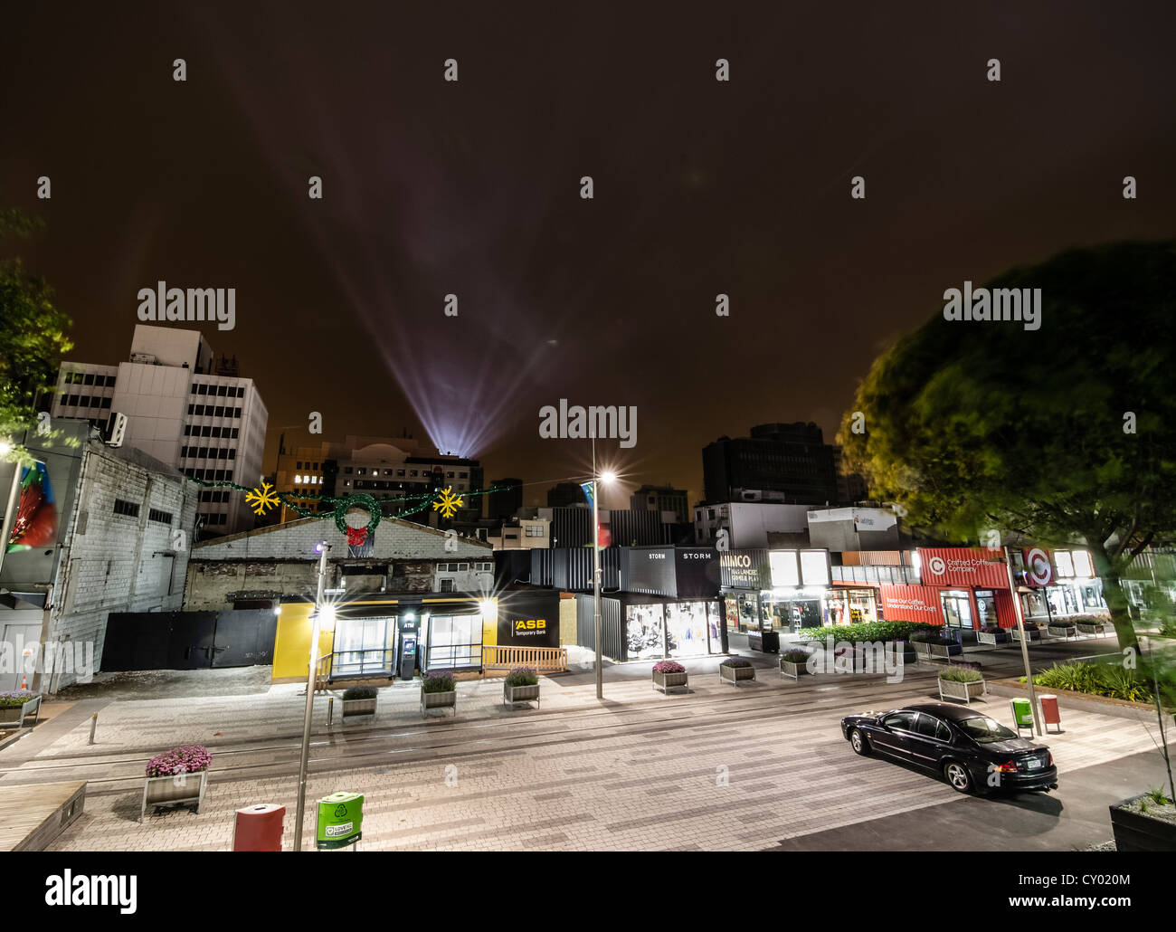 Shops in containers after the earthquakes, rays of light as a memorial for the earthquake victims over the city - Stock Image