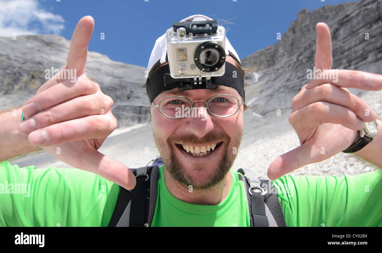 Young man, mountain hiker with a GoPro HD Video Camera mounted to his head, Karwendel Mountains National Park, Tyrol, Austria Stock Photo
