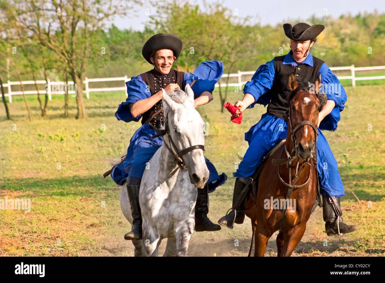 Hungary, Kalocsa, Csikos Hungarian horse riders. - Stock Image