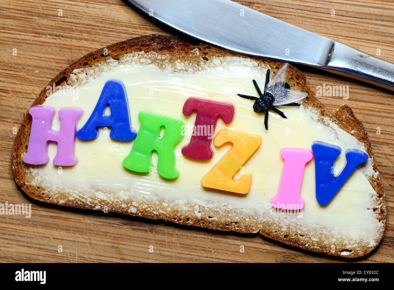 Lettering 'Hartz IV' on a sandwich, symbolic image for Hartz 4 - Stock Image