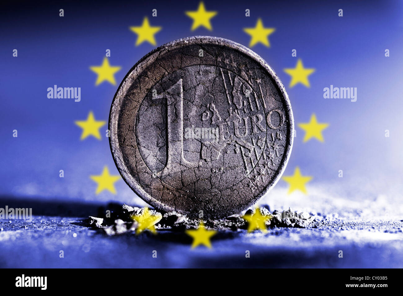 Burnt 1 Euro Coin In Ashes Surrounded By The Stars Of The Eu Stock