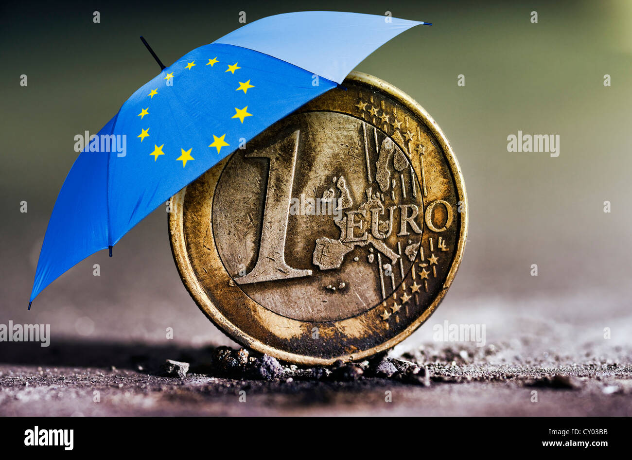 Burnt 1 Euro Coin In Ashes Under An Umbrella With The Stars Of The