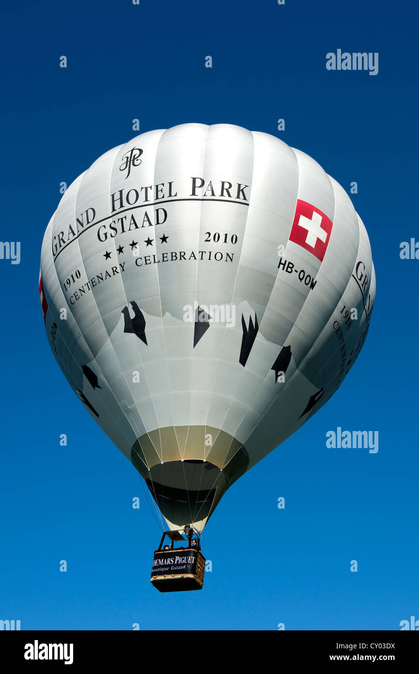 Hot air balloon HB QOW Cameron Z-120 of the Grand Hotel Park Gstaad, Switzerland, Europe - Stock Image