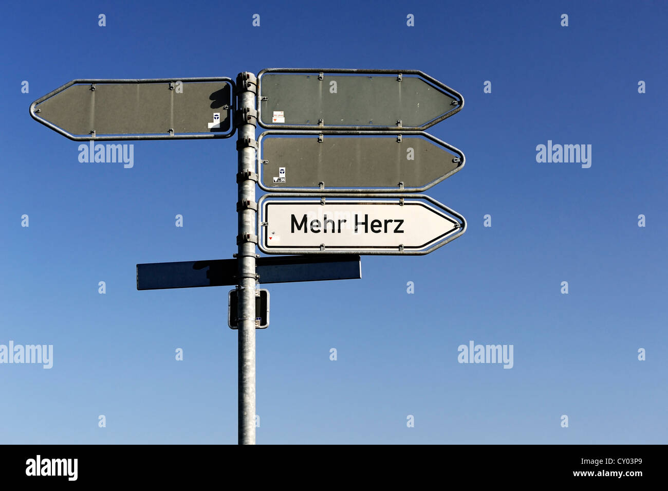 Signpost to 'Mehr Herz', German for 'more heart', symbolic image - Stock Image