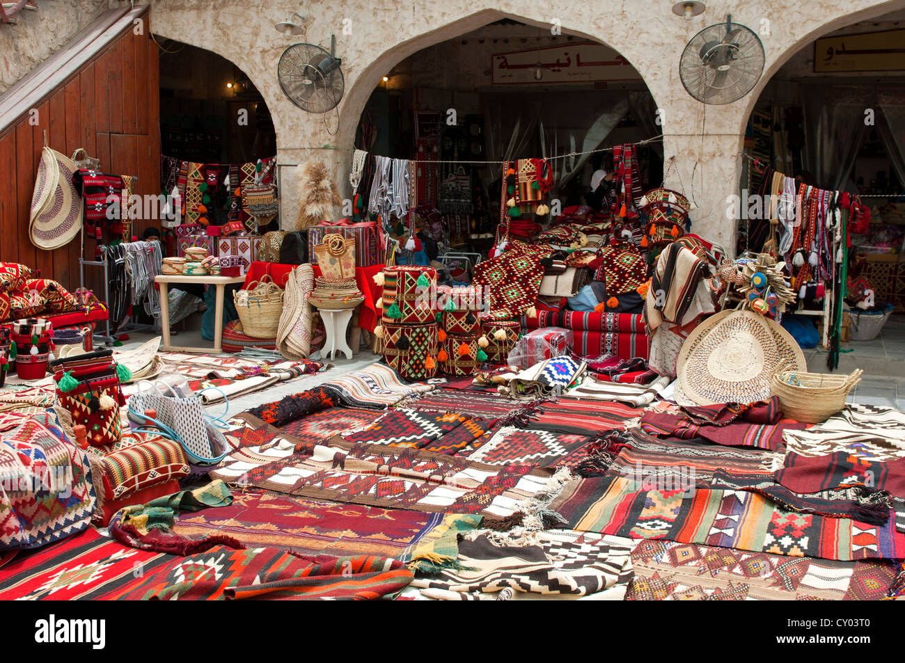 Market stall for carpets and cushions in the souk of Doha, Qatar, Middle East - Stock Image
