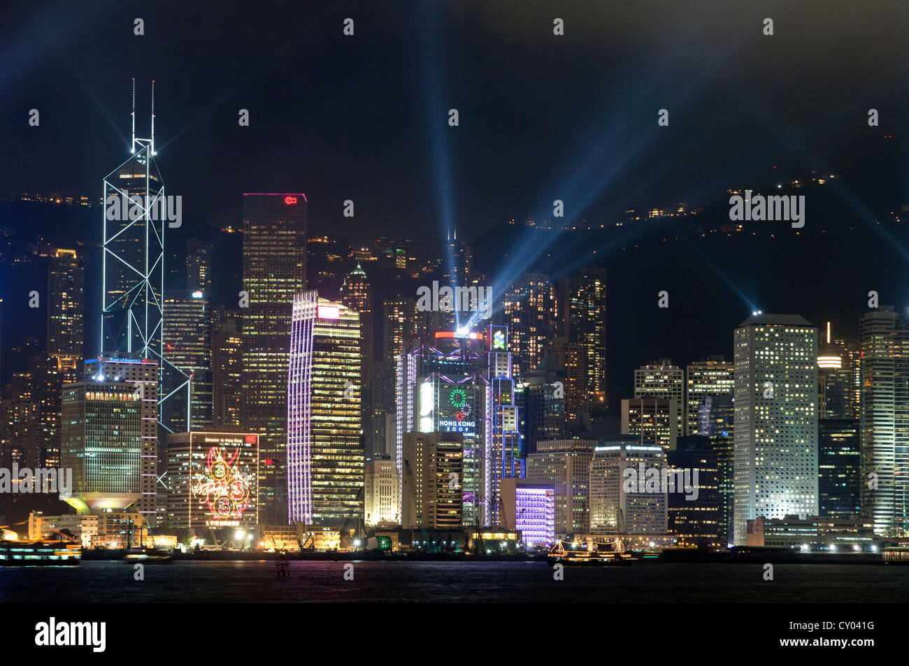 Laser light show on the skyscrapers of the Central District of Hong Kong Island as seen from Kowloon, Hong Kong, - Stock Image