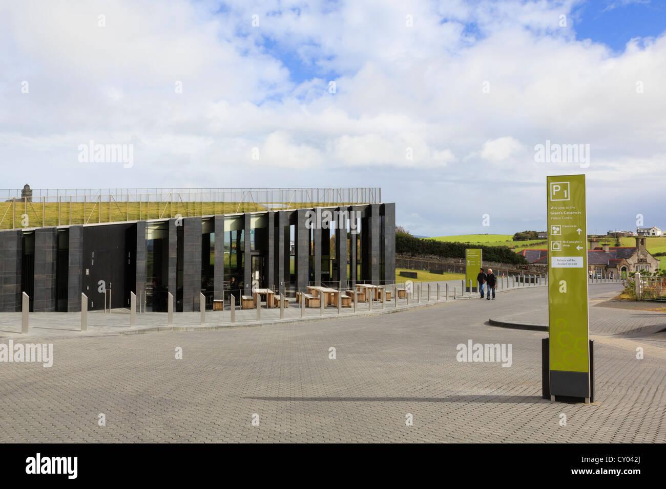 The new Giant's Causeway visitors centre building with grass roof and basalt columns. Antrim Northern Ireland - Stock Image