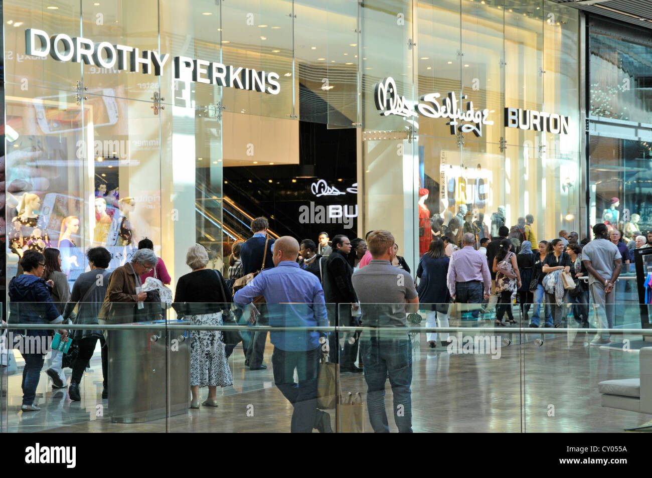 Adjacent shop fronts of Dorothy Perkins Miss Selfridge & Burton stores  all brands of the Arcadia Group in indoor - Stock Image
