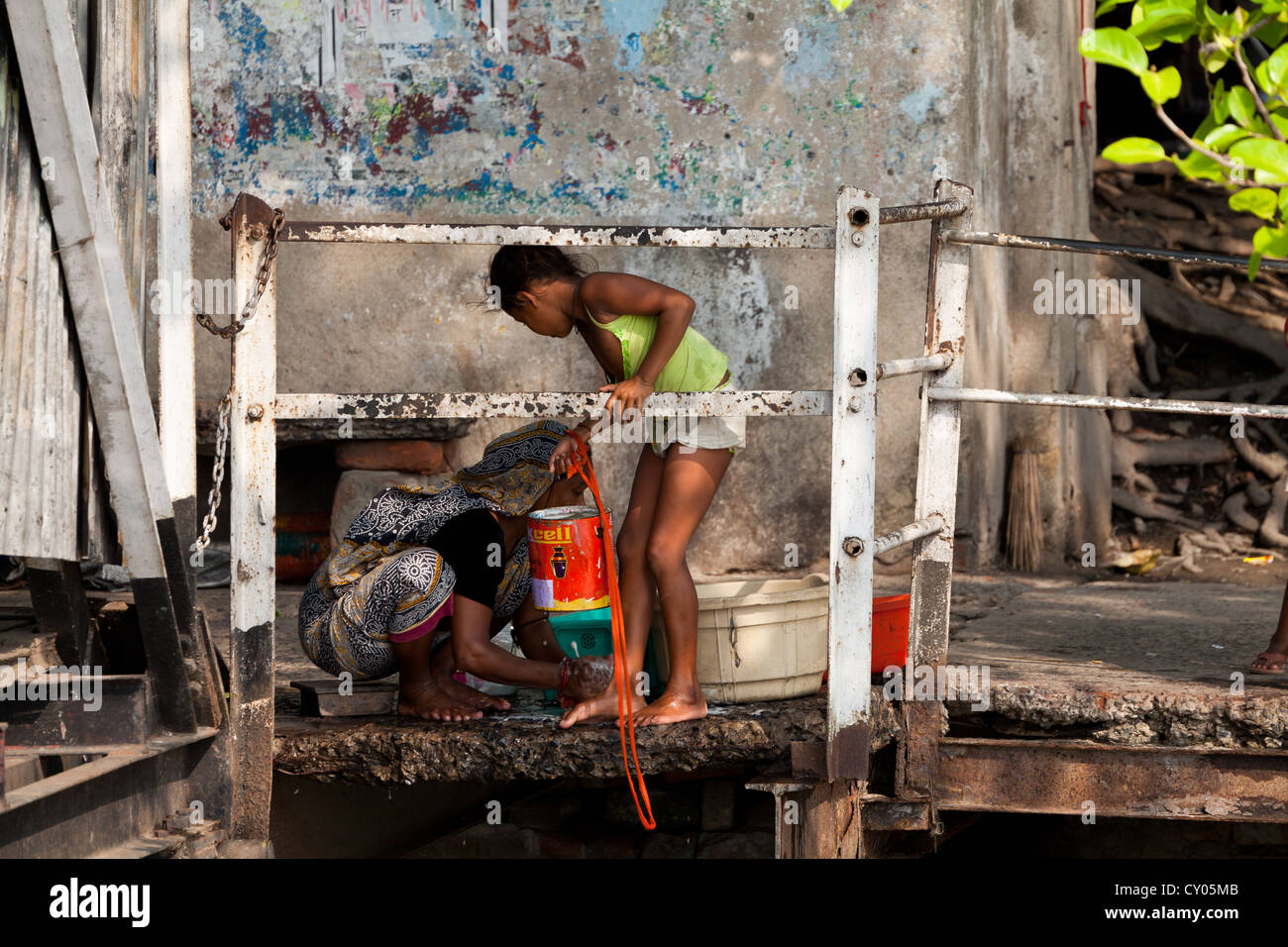 Mother and Girl doing Laundry on the River Banks in Kolkata, India Stock Photo
