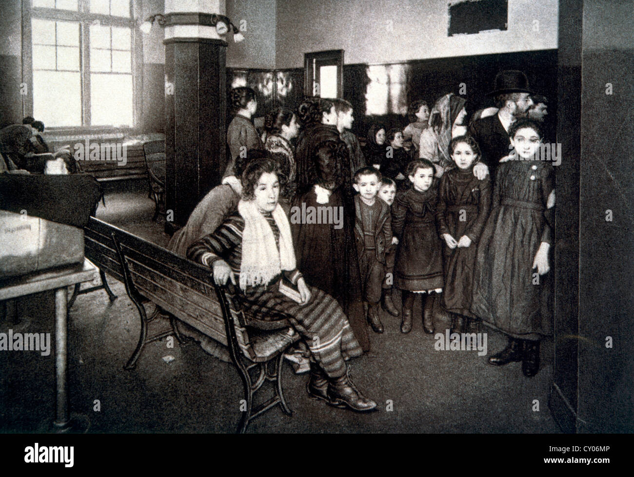 Group of Emigrants Waiting in the Detention Pen after Passing their Entrance Exam, Ellis Island, New York, USA, - Stock Image
